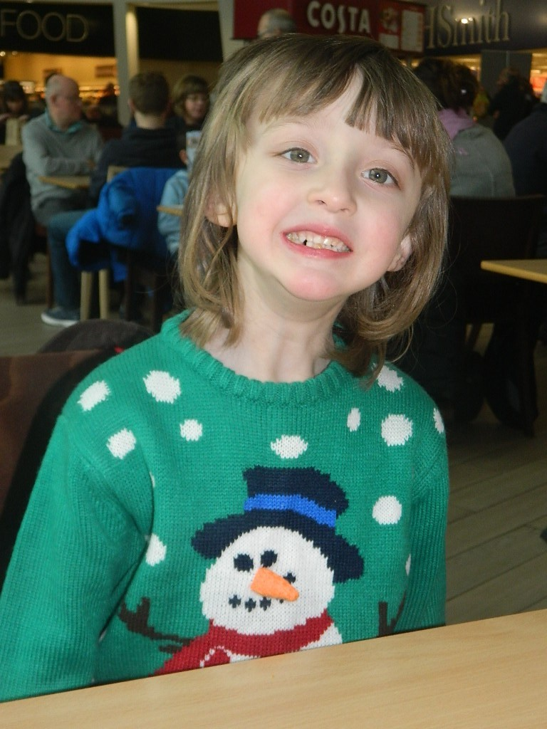 Christmas is my cutie in a Christmas jumper.