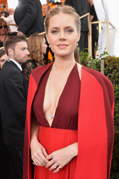 Amy Adams also in a cape from Maison Valentino.