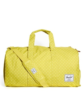 Herschel Novel Polka Dot Holdall £85.00 Click to visit ASOS