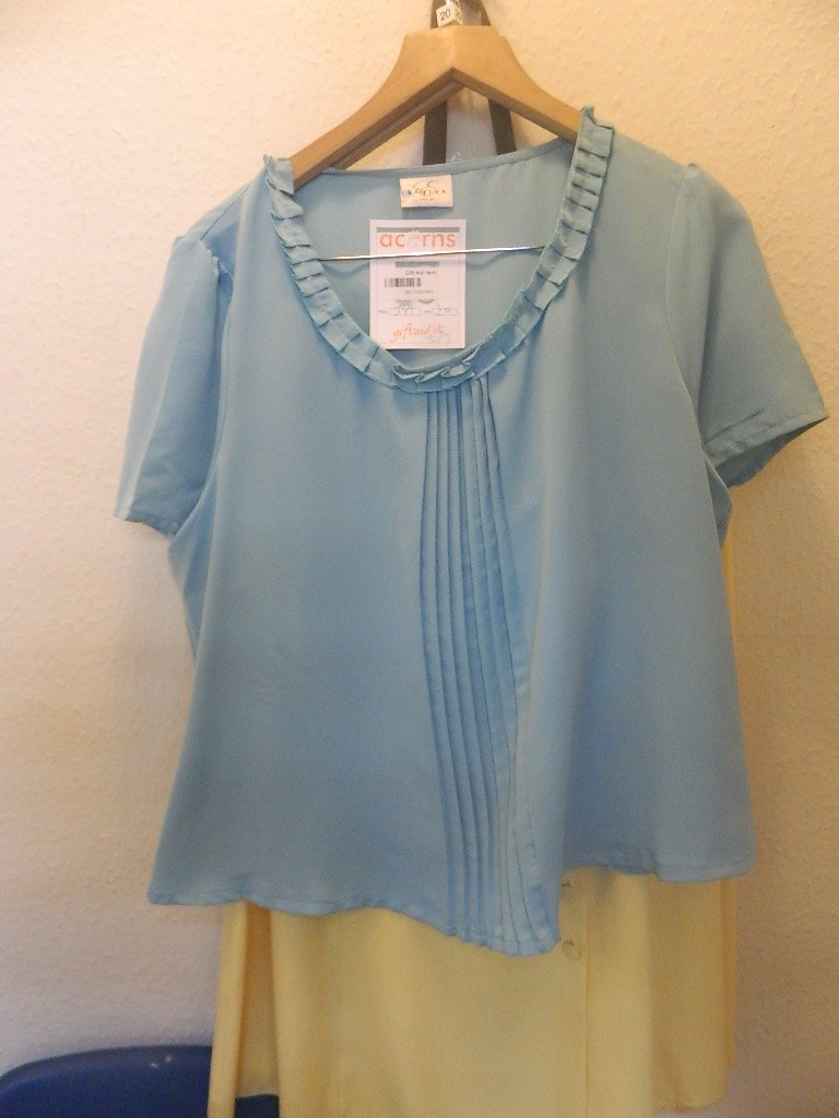 I really liked this blouse, but it needed to be tailored to make it more fitted - maybe buttons added down the back?