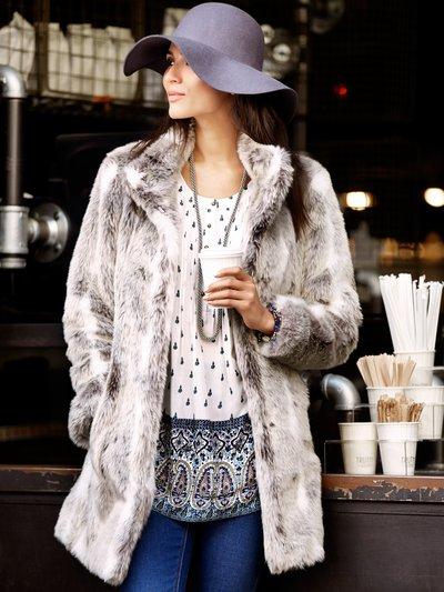 Faux fur coat £89 click to visit M&Co