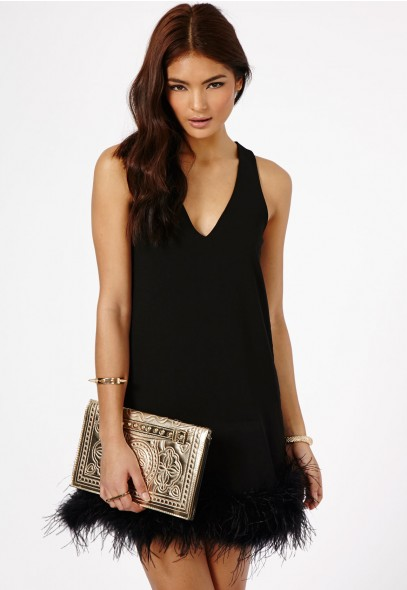 Claral Prom Dress With Feathered Hem Detail £39.99 click to visit Missguided