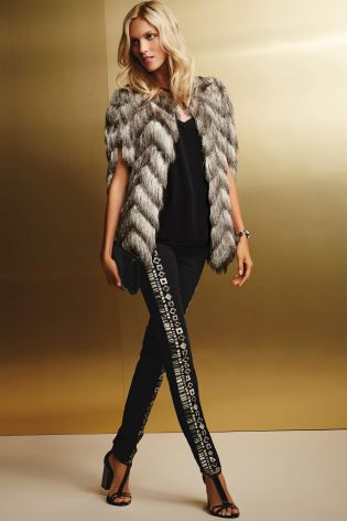 Eyelash Faux Fur Cape £55 click to visit Next