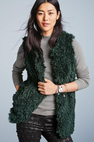 Shaggy Faux Fur Gilet £35 click to visit Next