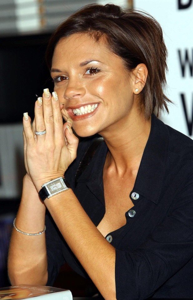 A rare smile from Victoria Beckham