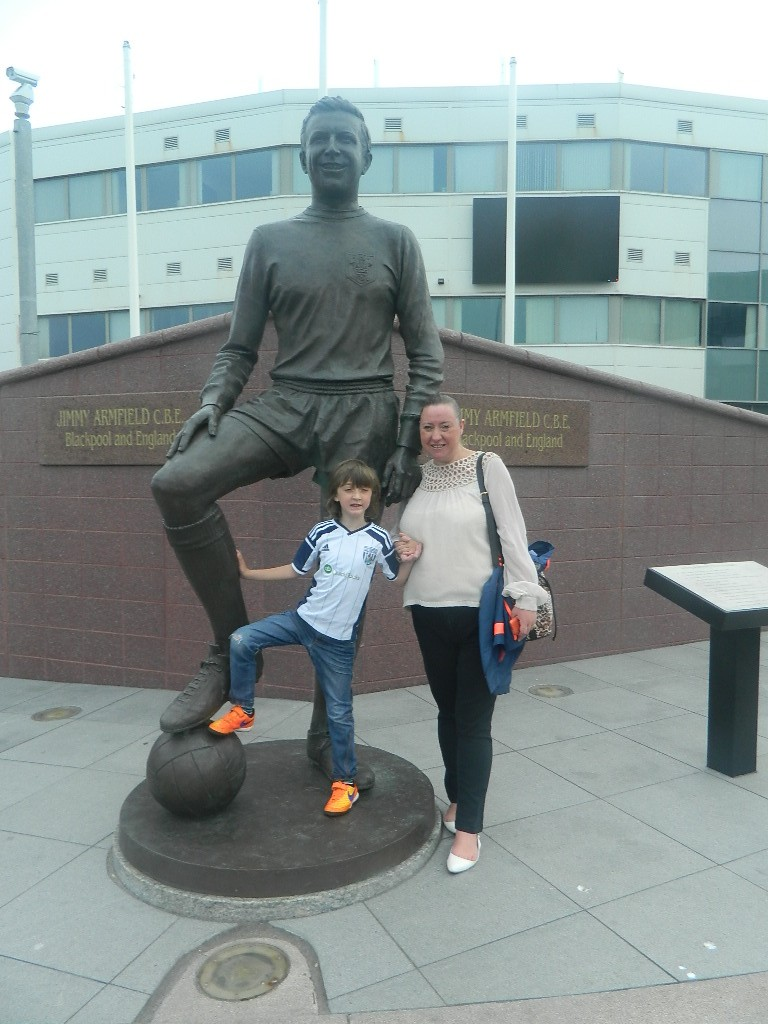With the Jimmy Arnfield statue outside Bloomfield Rd