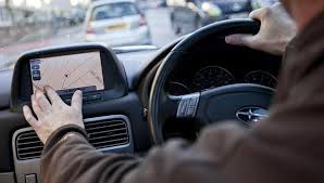 Set Sat Nav before you start driving, or stop to reset it.