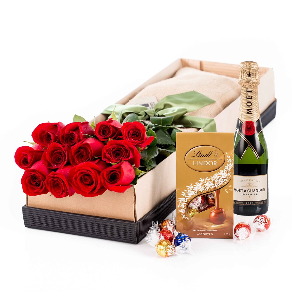 Roses - Sweet 12 Kisses with Moet Click to visit freshflowers.com.au