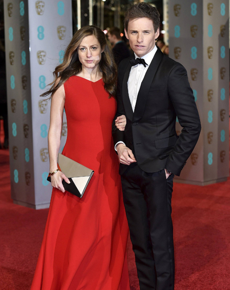 Actor Eddie Redmayne and his wife Hannah Bagshawe arrive at the British Academy of Film and Television Arts (BAFTA) Awards at the Royal Opera House in London, February 14, 2016. REUTERS/Toby Melville@@2016-02-14T190643Z_586455528_GF10000308525_RTRMADP_3_AWARDS-BAFTAS.JPG