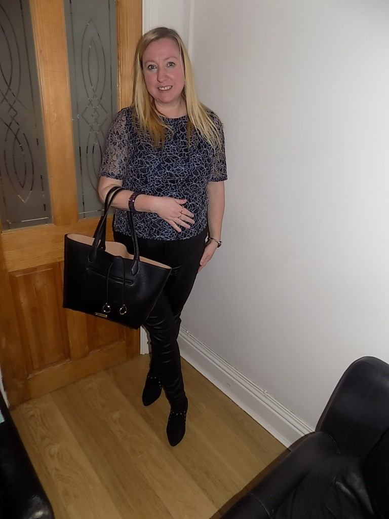 Lavitta top teamed with coated skinnies and ankle boots, plus a Steven Maddon bag.