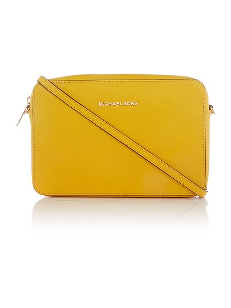 Michael Kors Jetset travel yellow crossbody bag £155 Click to visit House of Fraser