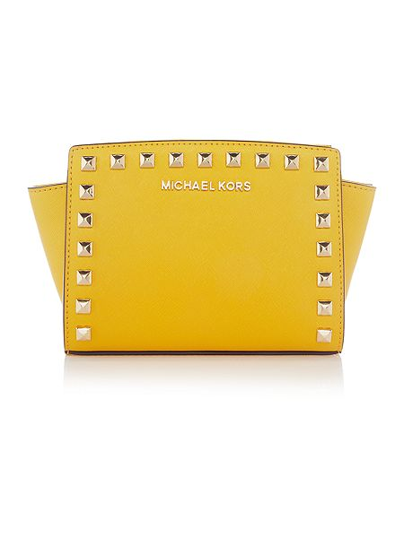 Michael Kors Selma yellow cross body bag £155 Click to visit House of Fraser