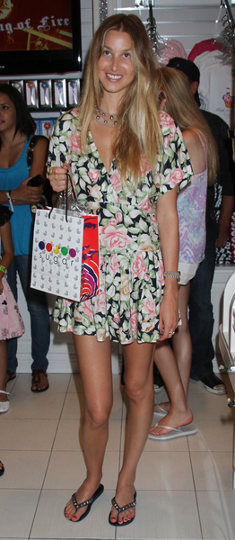 07/24/2010 - Whitney Port - Whitney Port Appears at the Sugar Factory in Las Vegas on July 24, 2010 - Sugar Factory Inside Miracle Mile Shops at Planet Hollywood Resort and Casino - Las Vegas, NV, USA - Keywords: black studded sandals, flip flop shoes, bag, ring, watch, candy, sugar factory, long wavy blonde hair, black dress with flower pattern, necklace, jewelry - 0 - - Photo Credit: PRN / PR Photos - Contact (1-866-551-7827)
