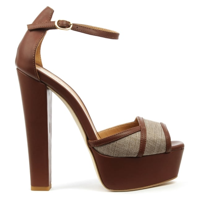 Angela Angalondra Tan Leather Platform Sandal Code: ANGALONDRA-Tnl Was: £175.00 Now £69.99 Click to visit Daniel Footwear