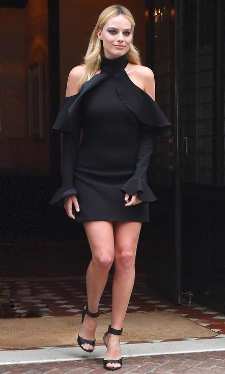 Margot Robbie seen wearing a black dress in New York City Pictured: Margot Robbie Ref: SPL1326493 280716 Picture by: Robert O'neil/Splash News Splash News and Pictures Los Angeles: 310-821-2666 New York: 212-619-2666 London: 870-934-2666 photodesk@splashnews.com