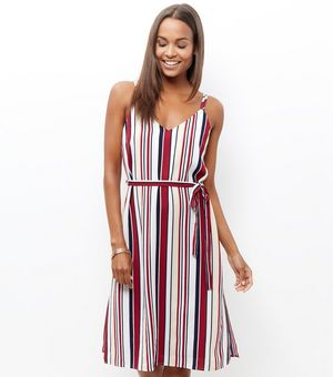 Cream Stripe Tie Waist Midi Dress £19.99 Click to visit New Look