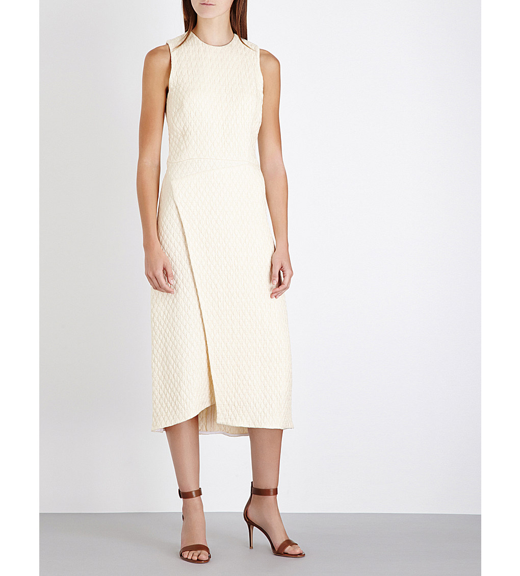 VICTORIA BECKHAM Wrapped quilted dress £1,720.00 Click to visit Selfridges