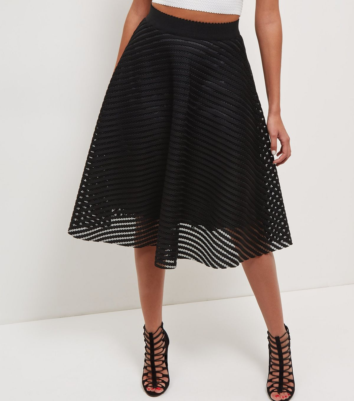 Black Mesh Stripe Midi Skirt £27.99 Click to visit New Look