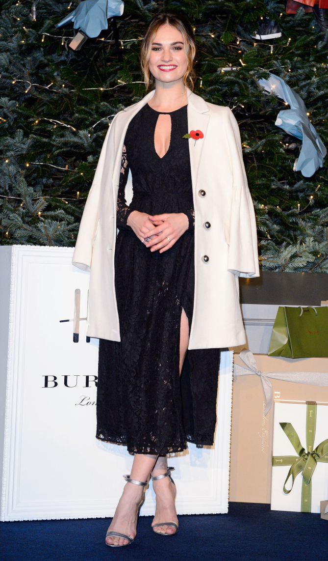 Mandatory Credit: Photo by Jonathan Hordle/REX/Shutterstock (6954419e) Lily James Harrods Christmas tree lighting ceremony, London, UK - 03 Nov 2016 WEARING BURBERRY X HARRODS COLLECTION