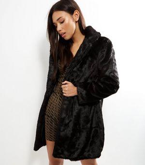 Black Faux Fur Coat £49.99 Click to visit New Look