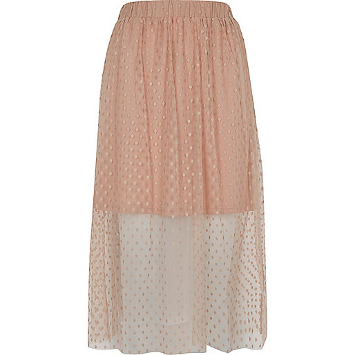 Nude polka dot tulle midi skirt Was £28.00 Now £15.00 Click to visit River Island