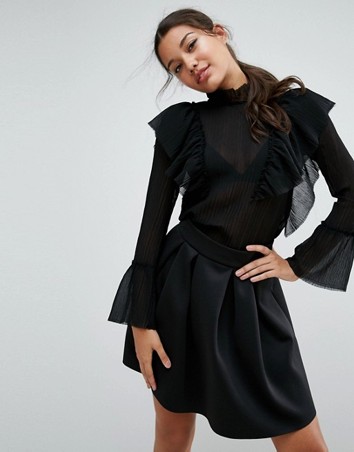 ASOS Premium Pleated Ruffle Blouse with Raw Edges £38.00 Click to visit ASOS